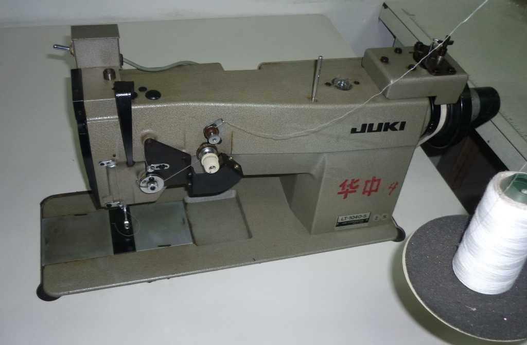 供应二手进口日本重机1040-5自动剪线临缝机.工业用西服缝纫设备